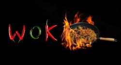 Word wok on a dark background asian wok