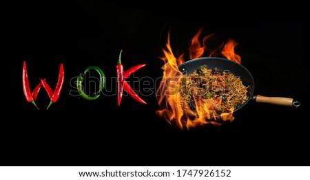 Word wok on a dark background asian wok Zdjęcia stock ©