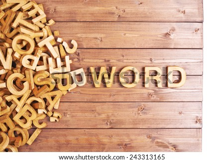 Word word made with block wooden letters next to a pile of other letters over the wooden board surface composition #243313165
