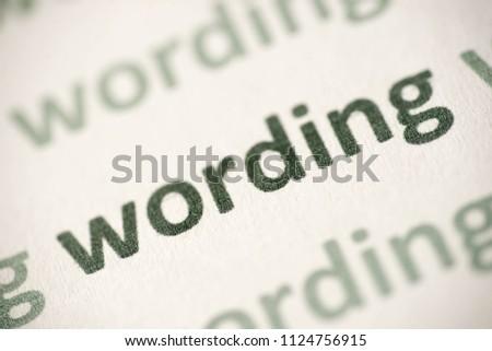 word wording printed on white paper macro #1124756915