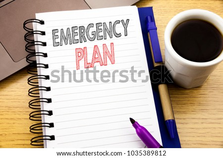 Word, writing Emergency Plan. Business concept for Disaster Protection written on notebook book on wooden background in the Office with laptop coffee #1035389812