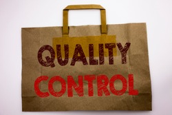 Word, writing Quality Control. Business concept for Improvement Work Written shopping bag, white isolated background.