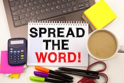 Word writing Spread The Word in the office with surroundings such as laptop marker pen stationery coffee Business concept for Announcement Business Marketing Message Workshop background space