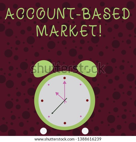 Word writing text Account Based Market. Business concept for resources target a key group of specific accounts Colorful Round Analog Two Bell Alarm Desk Clock with Seconds Hand photo.