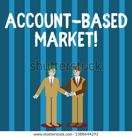 Word writing text Account Based Market. Business concept for resources target a key group of specific accounts Two Businessmen Standing, Smiling and Greeting each other by Handshaking.