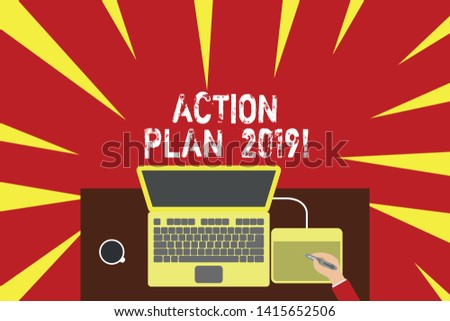 Word writing text Action Plan 2019. Business concept for proposed strategy or course of actions for current year Upper view laptop wooden desk worker drawing tablet coffee cup office.