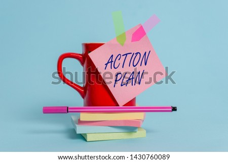 Word writing text Action Plan. Business concept for proposed strategy or course of actions for certain time Cup sticky note arrow banners stacked pads pen lying pastel background.
