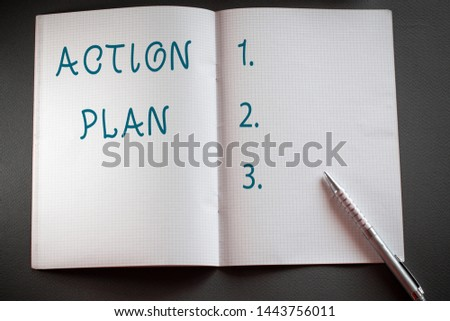 Word writing text Action Plan. Business concept for proposed strategy or course of actions for certain time Checkered math book and classic silver pen placed above textured work desk. #1443756011