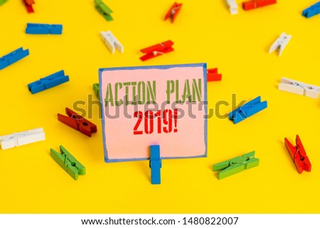 Word writing text Action Plan 2019. Business concept for proposed strategy or course of actions for current year Colored clothespin papers empty reminder yellow floor background office. #1480822007