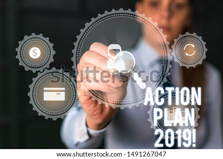 Word writing text Action Plan 2019. Business concept for proposed strategy or course of actions for current year Woman wear formal work suit presenting presentation using smart device.