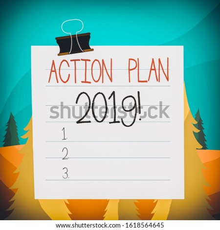 Word writing text Action Plan 2019. Business concept for proposed strategy or course of actions for current year Paper lines binder clip cardboard blank square notebook color background.