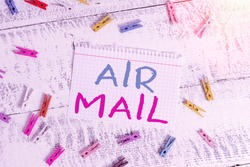 Word writing text Air Mail. Business concept for the bags of letters and packages that are transported by aircraft Colored clothespin rectangle square shaped paper white wood background.