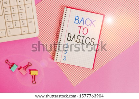 Word writing text Back To Basics. Business concept for Return simple things Fundamental Essential Primary basis Writing equipments and computer stuffs placed above colored plain table.