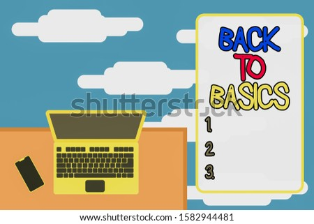 Word writing text Back To Basics.  Upper view office working place laptop lying wooden desk smartphone side.