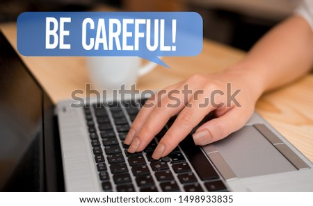 Word writing text Be Careful. Business concept for making sure of avoiding potential danger mishap or harm woman laptop computer smartphone mug office supplies technological devices. #1498933835