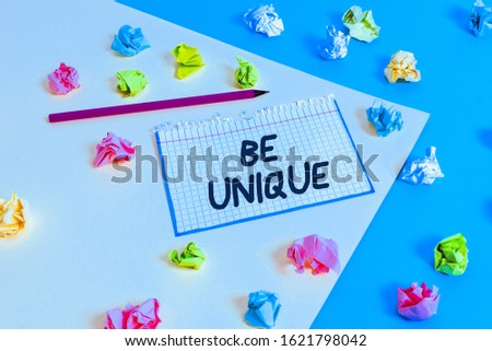 Word writing text Be Unique. Business concept for being the only one of its kind Unlike anything else Incomparable Colored crumpled papers empty reminder blue yellow background clothespin.