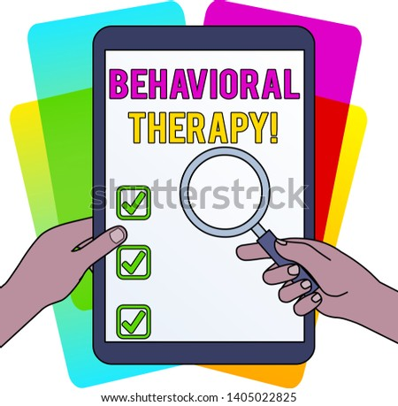 Word writing text Behavioral Therapy. Business concept for help change potentially selfdestructive behaviors Hands Holding Magnifying Glass Against Switched Off Touch Screen Tablet.
