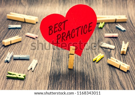 Word writing text Best Practice. Business concept for Method Systematic Touchstone Guidelines Framework Ethic Clothespin holding red paper heart several clothespins wooden floor romance.