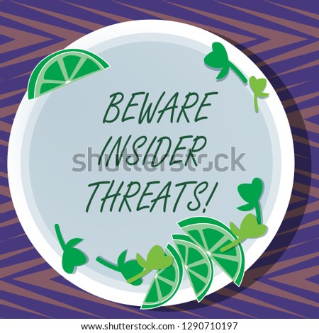Word writing text Beware Insider Threats. Business concept for Be cautious on malicious attack inside the network Cutouts of Sliced Lime Wedge and Herb Leaves on Blank Round Color Plate.
