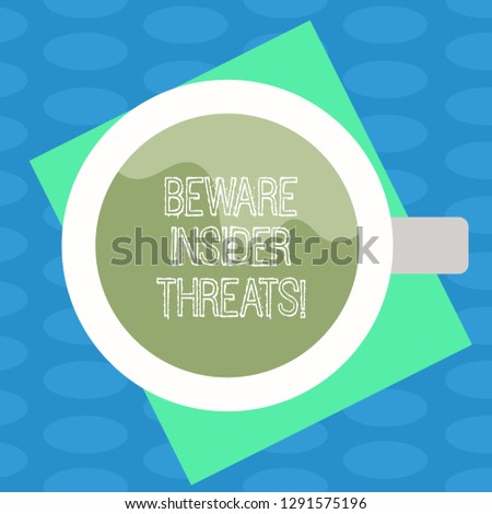Word writing text Beware Insider Threats. Business concept for Be cautious on malicious attack inside the network Top View of Drinking Cup Filled with Beverage on Color Paper photo.
