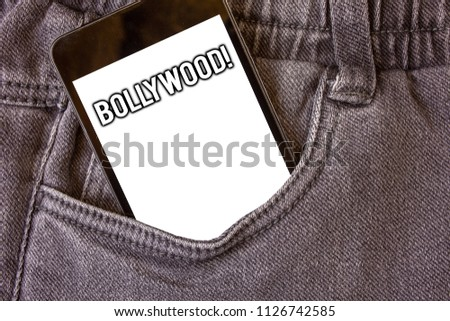 Word writing text Bollywood Motivational Call. Business concept for Hollywood Movie Film Entertainment Cinema Cell phone jean pocket white screen message communicate applications. #1126742585