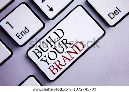 Word writing text Build Your Brand. Business concept for create your own logo slogan Model Advertising E Marketing written White Keyboard Key with copy space. Top view.