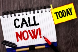 Word writing text Call Now. Business concept for Contact Talk Chat Hotline Support Telephony Customer Service written on Notebook Book on the wooden background Today Marker next to it.
