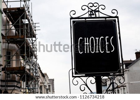 Word writing text Choices. Business concept for Preference Discretion Inclination Distinguish Options Selection Vintage black board sky old city vintage antique ideas message scaffolding.