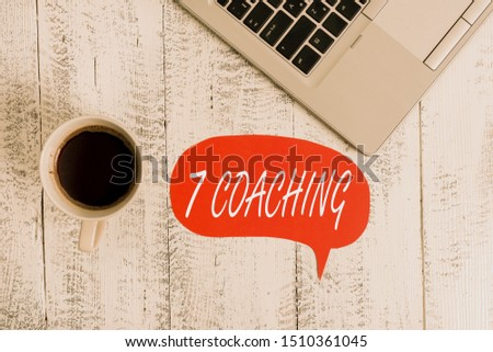 Word writing text 7 Coaching. Business concept for Refers to a number of figures regarding business to be succesful Trendy metallic open laptop speech bubble vintage wooden table coffee cup.