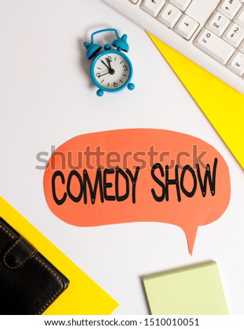 Word writing text Comedy Show. Business concept for Funny program Humorous Amusing medium of Entertainment Flat lay with copy space on bubble paper clock and paper clips. #1510010051