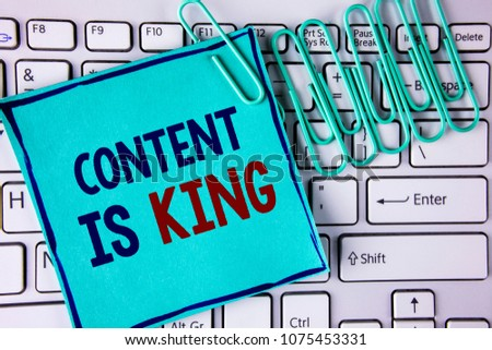 Word writing text Content Is King. Business concept for articles or posts can guarantee you success Advertising written on Sticky Note Paper placed on White Keyboard Paper Pins next to it.