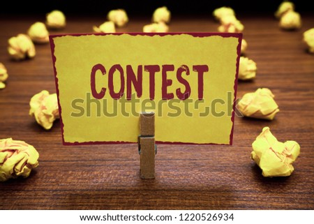 Word writing text Contest. Business concept for Competition do better than other showing for prize Election Clothespin holding yellow paper note crumpled papers several tries mistakes. #1220526934
