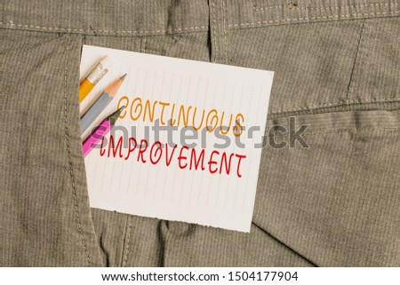 Word writing text Continuous Improvement. Business concept for ongoing effort to improve products or processes Writing equipment and white note paper inside pocket of man work trousers.