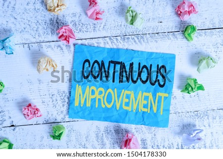 Word writing text Continuous Improvement. Business concept for ongoing effort to improve products or processes Crumpled colored rectangle square shaped paper reminder white wood desk.