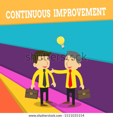 Word writing text Continuous Improvement. Business concept for ongoing effort to improve products or processes Two White Businessmen Colleagues with Brief Cases Sharing Idea Solution.