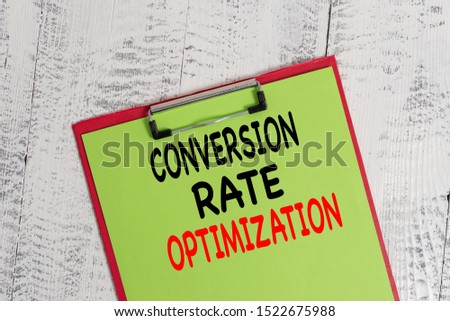 Word writing text Conversion Rate Optimization. Business concept for system for increasing percentage of visitors Colored clipboard blank paper sheet old retro wooden vintage background.