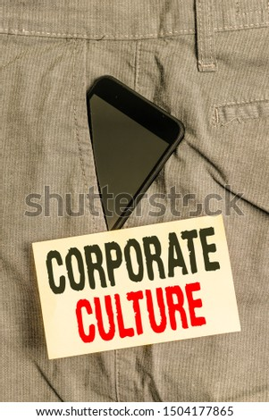 Word writing text Corporate Culture. Business concept for pervasive values and attitudes that characterize a company Smartphone device inside formal work trousers front pocket near note paper.