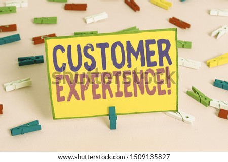 Word writing text Customer Experience. Business concept for product of interaction between organization and buyer Colored clothespin papers empty reminder pink floor background office pin.