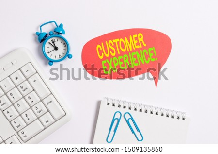 Word writing text Customer Experience. Business concept for product of interaction between organization and buyer Blank paper with copy space on the table with clock and pc keyboard.