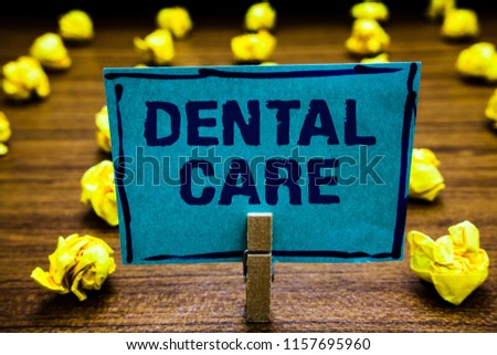 Word writing text Dental Care. Business concept for maintenance of healthy teeth or to keep it clean for future Clothespin holding blue paper note crumpled papers several tries mistakes.