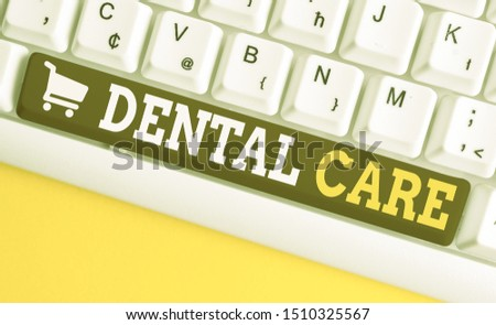 Word writing text Dental Care. Business concept for maintenance of healthy teeth or to keep it clean for future White pc keyboard with empty note paper above white background key copy space.