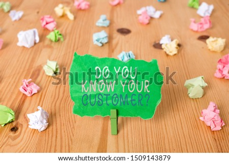 Word writing text Do You Know Your Customer Question. Business concept for service identify clients with relevant information Colored crumpled papers empty reminder wooden floor background clothespin.