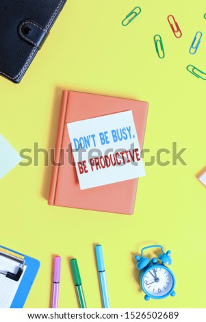 Word writing text Don T Be Busy Be Productive. Business concept for Work efficiently Organize your schedule time Flat lay above table with copy space paper clips clock and pencils. #1526502689