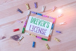 Word writing text Driver S License. Business concept for a document permitting a demonstrating to drive a motor vehicle Colored clothespin papers empty reminder wooden floor background office.