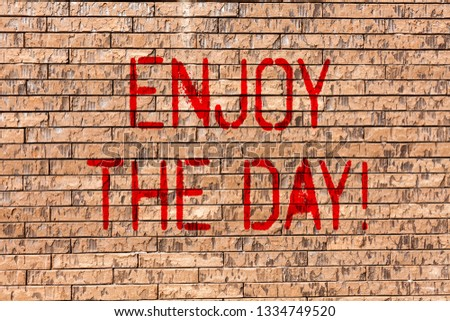 Word writing text Enjoy The Day. Business concept for Enjoyment Happy Lifestyle Relaxing Time Brick Wall art like Graffiti motivational call written on the wall. #1334749520