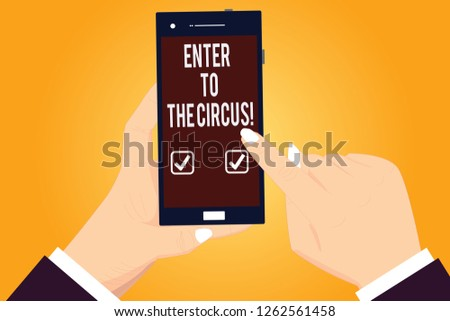 Word writing text Enter To The Circus. Business concept for Go to the show festival recreation entertainment Hu analysis Hands Holding Pointing Touching Smartphone Blank Color Screen.