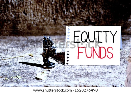Word writing text Equity Funds. Business concept for type of mutual fund that buys ownership in businesses Bronze Knight Chessman Blank Spiral Notepad Sheet Folded in Half Dry Leaves.