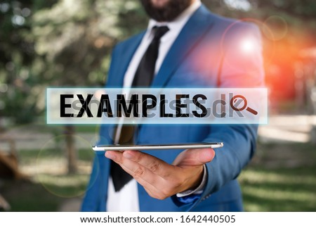 Word writing text Examples. Business concept for Illustration Sample Model to follow Guide Explanation For instance Businessman in blue suite stands with mobile phone in hands. ストックフォト ©
