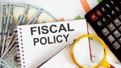 Word writing text FISCAL POLICY . Business concept with chart, dollars ,office tools