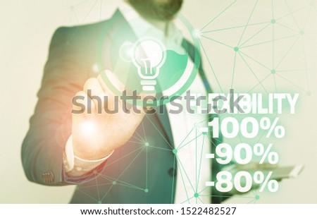 Word writing text Flexibility 100 Percent 90 Percent 80 Percent. Business concept for How much flexible you are maleability level Male human wear formal work suit presenting presentation using smart